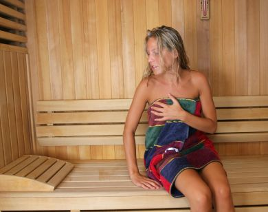 Woman in multicolor towel in sauna