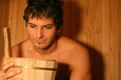 Man in Sauna  Close Up With Bucket