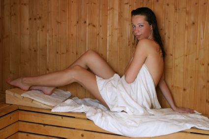 Woman in Sauna on Bench