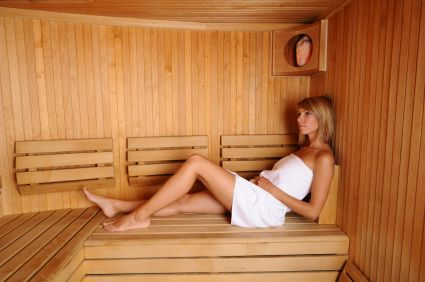 Young lady relaxed in the sauna